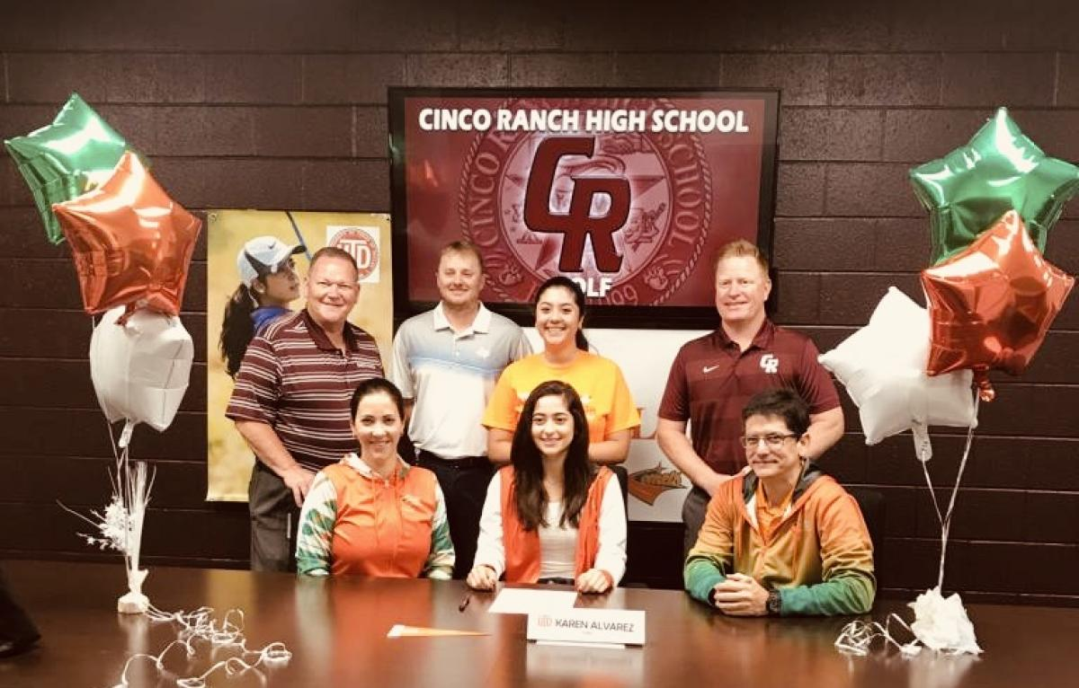 Karen Alvarez signs her letter of intent to play golf at the University of Texas - Dallas